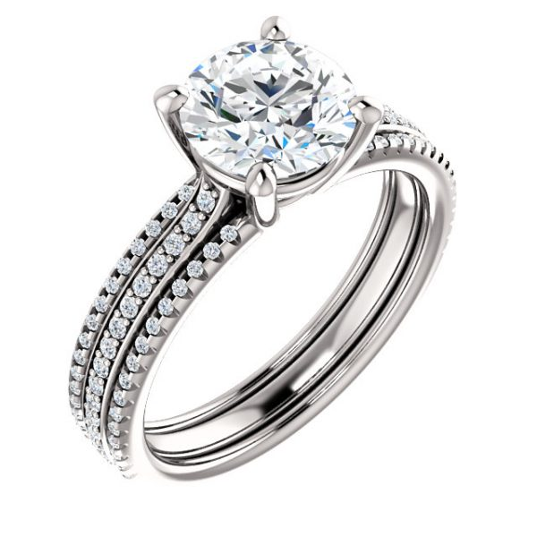 Classic 4 prong with 3 rows of accented side stones.