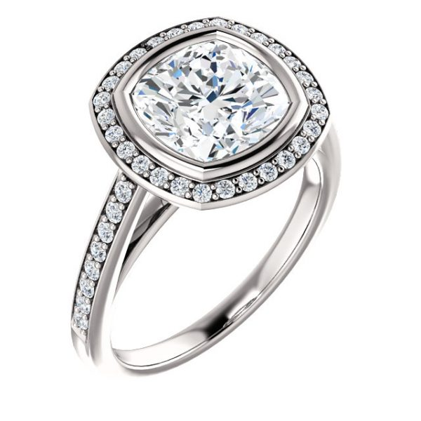 Bezel set halo with accented side stones